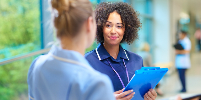 Two healthcare workers talking with each other