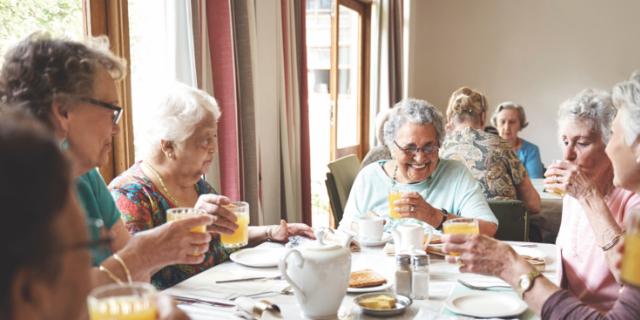 happy seniors eating breakfast